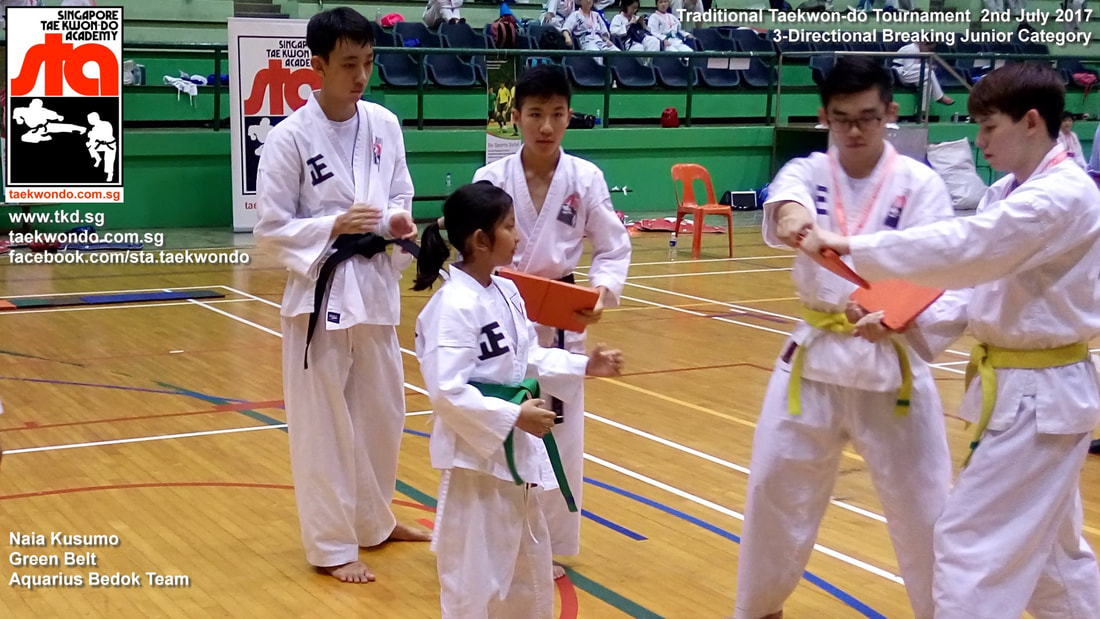 Naia Kusumo Green Belt Breaking Board Powerful Kick Competition Tournament Kids Children Self Defence Martial Arts Aquarius Bedok Reservoir Tampines Club School Adrian Huan Senior Instructor Singapore Taekwon-do Academy HQ Traditional Taekwondo STA TKD SG